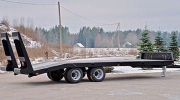 Plošinový návěs pro přepravu strojů PT 5750